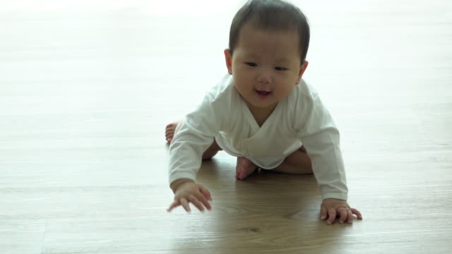 slow motion baby crawling on the floor - flooring stock videos & royalty-free footage