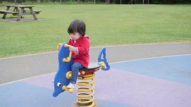 slow motion Baby girl playing Rocking horse
