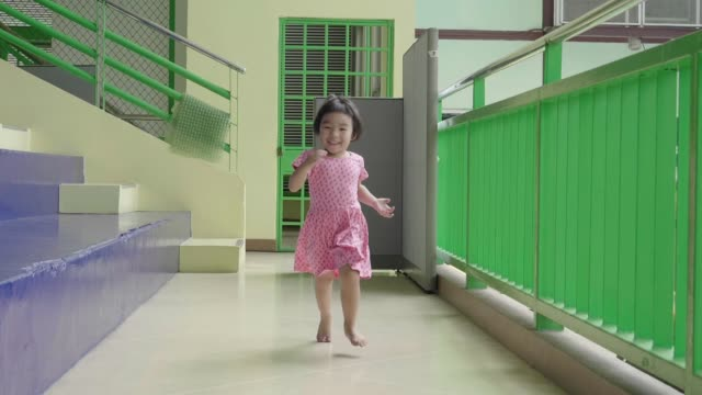 slow motion baby girl running - corridor stock videos & royalty-free footage