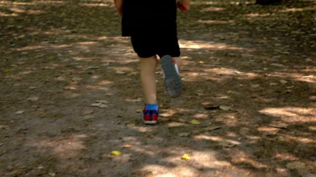 Slow motion: Baby run on sidewalk