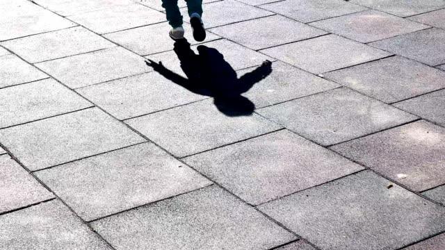 slow motion: baby walk on sidewalk - shadow stock videos & royalty-free footage