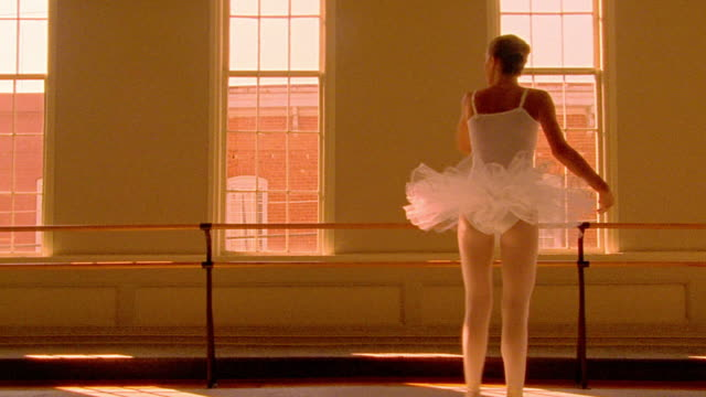 vidéos et rushes de orange slow motion ballerina spinning + jumping / windows in background - seulement des jeunes filles