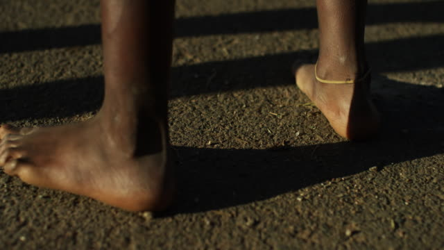 Slow motion, barefeet on pavement in South Africa