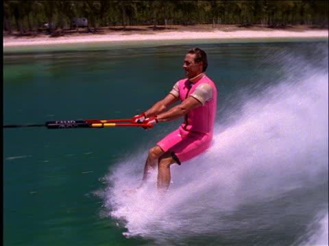 slow motion barefoot man waterskiing / stunts- flipping - 50秒以上点の映像素材/bロール