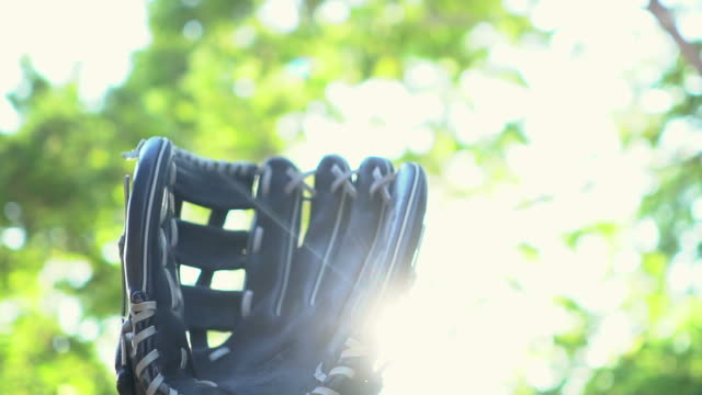 slow motion: baseball catching by baseball glove - baseball pitcher stock videos & royalty-free footage