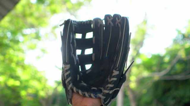 slow motion: baseball catching by baseball glove - sports glove stock videos and b-roll footage
