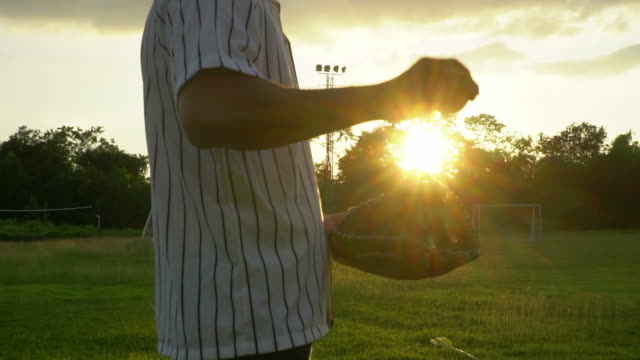 slow motion: baseball catching by baseball glove - home run stock-videos und b-roll-filmmaterial