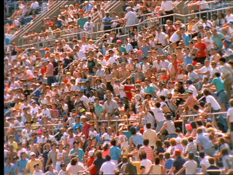 vídeos de stock, filmes e b-roll de slow motion baseball hit into crowd in shea stadium / long island, ny - flushing meadows corona park