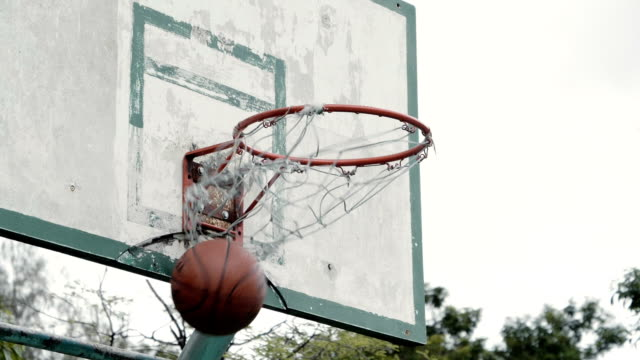 slow motion : basketball going through a hoop - basket stock videos & royalty-free footage