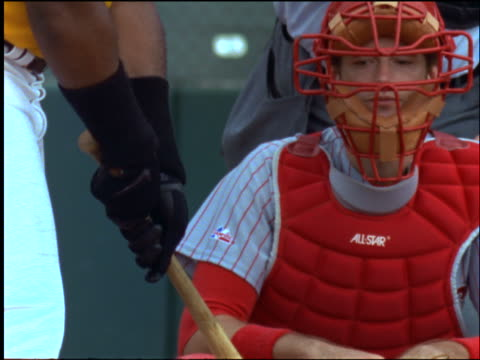 slow motion batter practicing swing as catcher looks on