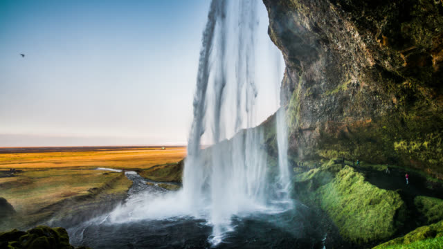 slow motion behind the waterfall - iceland - waterfall stock videos & royalty-free footage
