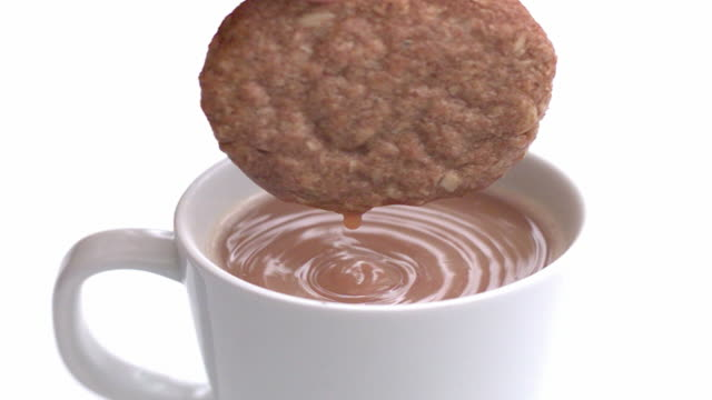 slow motion biscuit dunk - tea stock videos and b-roll footage