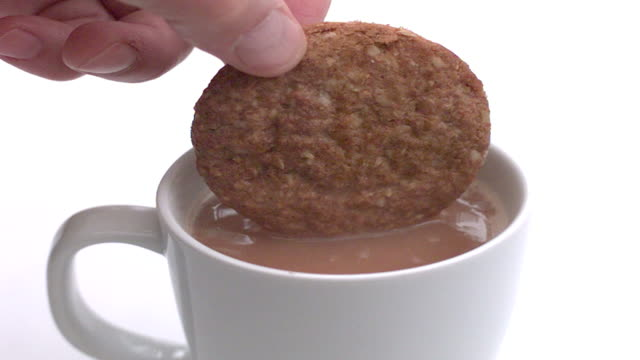 slow motion biscuit dunk - dipping stock videos & royalty-free footage