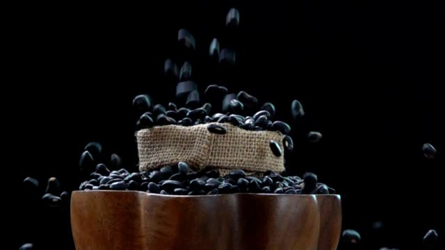 slow motion black beans - bean stock videos & royalty-free footage