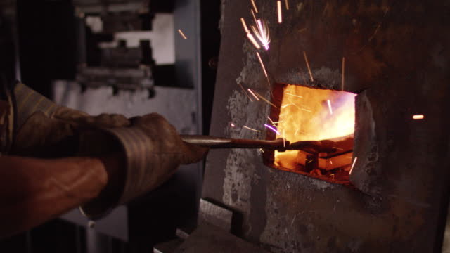 slow motion, blacksmith uses forge - blacksmith stock videos & royalty-free footage
