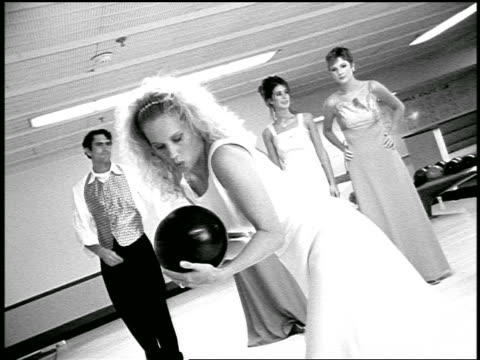 vídeos y material grabado en eventos de stock de b/w slow motion blonde bride rubbing bowling ball for good luck while bridesmaids + ushers watch - bola de bolos
