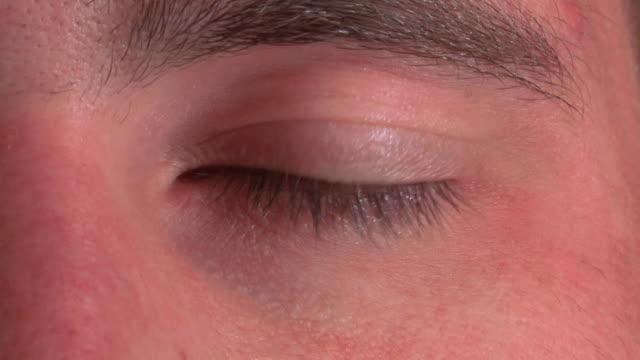 slow motion blue eye blinking - cornea stock videos & royalty-free footage