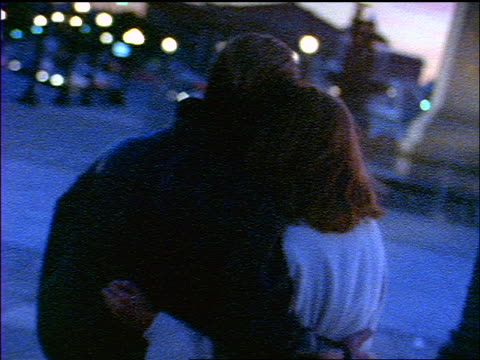 slow motion blue grainy couple kissing + walking away from camera on city sidewalk at twilight / paris - 1 minute or greater stock videos & royalty-free footage