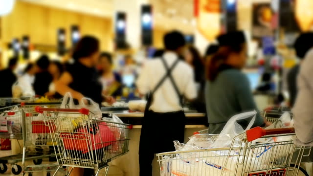 HD Slow Motion: Blurred cashier counter in the supermarket