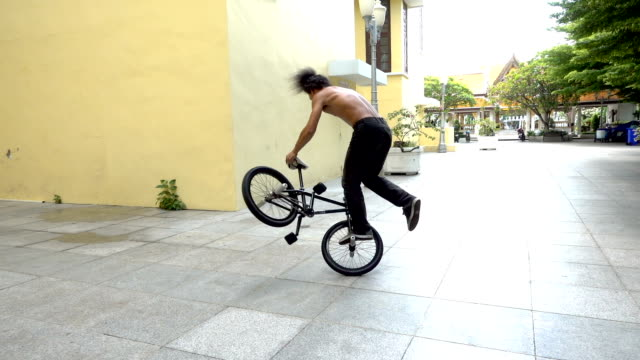 slow motion bmx flatland spin trick , asian model. - stunt stock videos and b-roll footage