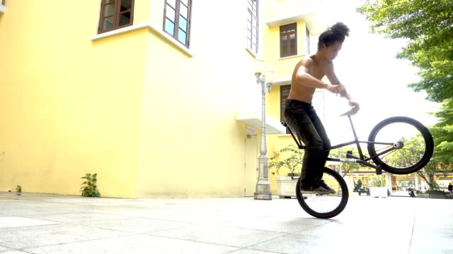 Slow Motion BMX Flatland spin trick , Asian Model.