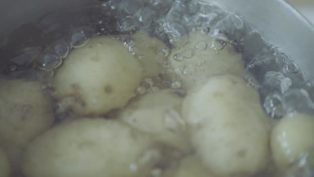 slow motion boiling baby potato in a  pot - raw potato stock videos & royalty-free footage