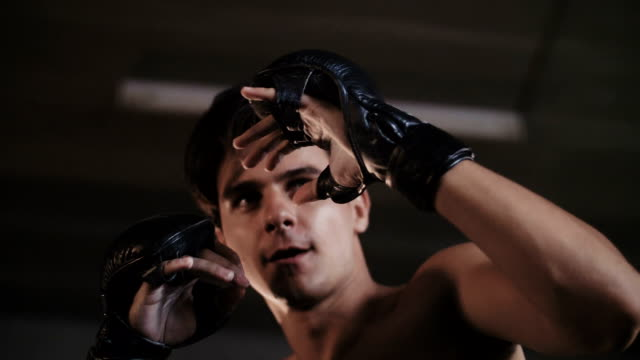 slow motion : boxing class at the gym - glove fist stock videos & royalty-free footage