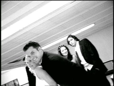 vídeos y material grabado en eventos de stock de b/w slow motion bride + groom pose with bowling ball in bowling alley / bride sticks out tongue, makes face - bola de bolos