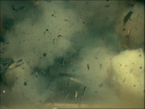 slow motion broken debris flying during explosion