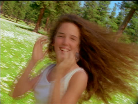 slow motion brunette girl with long hair spinning in field of flowers + posing for camera / montana - 1997 stock videos & royalty-free footage
