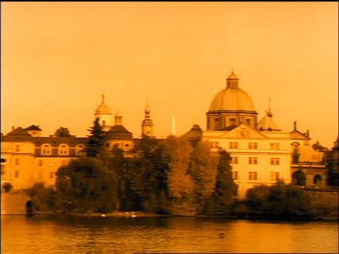sepia slow motion pan buildings to charles bridge / prague, czech republic - charles bridge stock videos & royalty-free footage