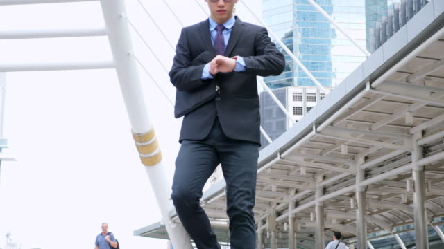 Slow Motion Businessman Hurry to Work While Running on the Stairway