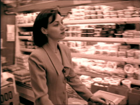 b/w sepia slow motion pan businesswoman pushing cart in supermarket - sepia stock videos and b-roll footage