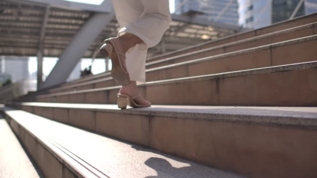 slow motion businesswoman running up the stairs - authority stock videos & royalty-free footage