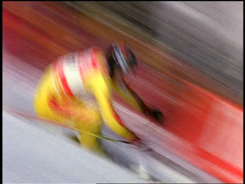 slow motion PAN Canadian downhill skier speeding down steep slope past camera / Colorado