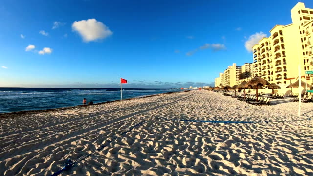 slow motion: cancun beach at sunset - palapa stock videos & royalty-free footage