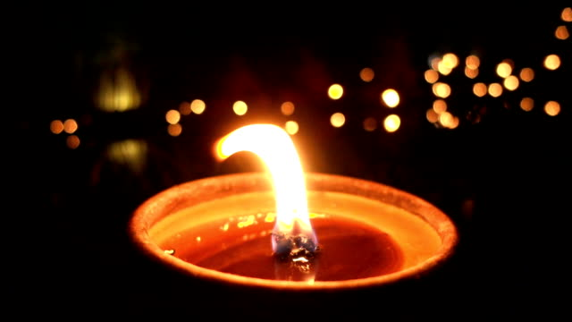 slow motion candle light in buddhism event - religion stock videos & royalty-free footage