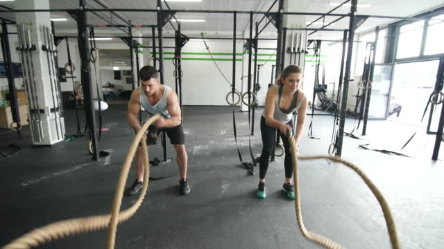 Slow motion capture of a gym battle rope exercise