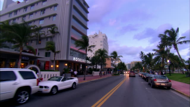 Slow motion car point of view moving down Ocean Drive/ Miami Beach, Florida