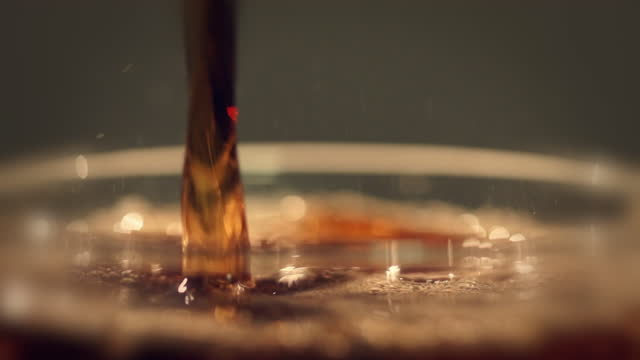 slow motion carbonated drinks in glass - carbonated stock videos & royalty-free footage