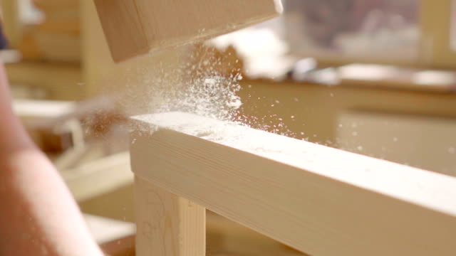 Slow motion: Carpenter using hammer