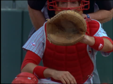 slow motion catcher waiting for pitch with mitt open / catches baseball + prepares to throw it