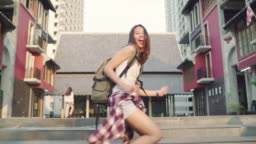 Slow motion - Cheerful beautiful young Asian backpacker blogger woman feeling happy dancing on street while traveling at Chinatown in Beijing, China. Lifestyle backpack tourist travel holiday concept.