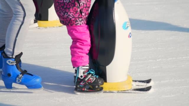 Slow motion: child learning ice Skating
