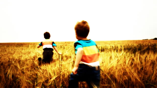 slow motion: children running in wheat field - sepia stock videos and b-roll footage