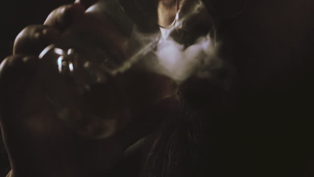 slow motion  : cigarette and alcohol - alcohol drink stock videos & royalty-free footage