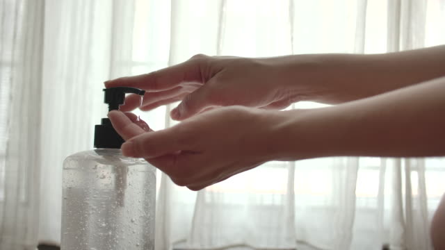 slow motion cleaning hand with alcohol gel - shampoo stock videos & royalty-free footage