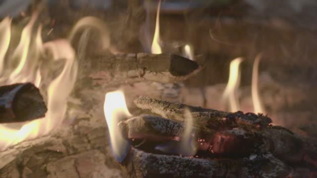 Slow motion close shot of a campfire.