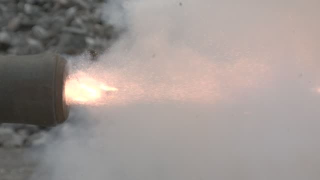 slow motion close shot of a cannon ball firing from a cannon. - shooting a weapon stock videos & royalty-free footage
