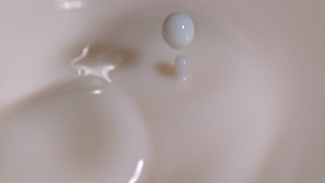 slow motion close shot of milk being dropped into a glass. - milk stock videos & royalty-free footage